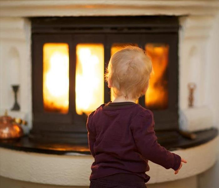 Kid looking at fireplace